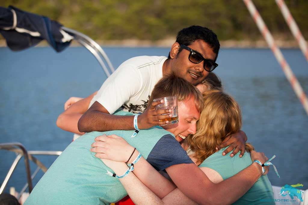 People hugging on a sailing trip.