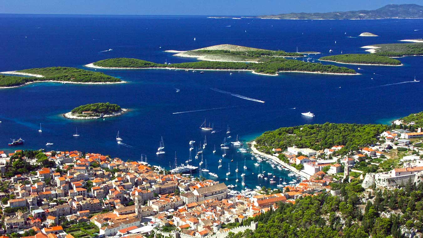 Aerial view of Hvar, Croatia. Many islands in the back. Port in front.